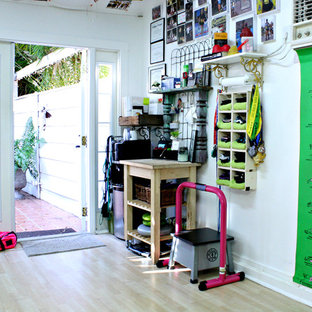 Eclectic multiuse home gym photo in Tampa with white walls