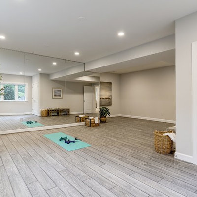 Example of a large transitional vinyl floor and brown floor home yoga studio design in DC Metro with beige walls