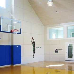 Indoor sport court - large traditional light wood floor and brown floor indoor sport court idea in Boston with beige walls