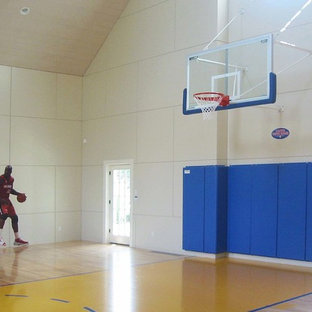 Example of a large classic light wood floor and beige floor indoor sport court design in Boston with beige walls