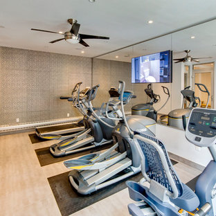 Contemporary home gym in New York with grey walls and porcelain flooring.