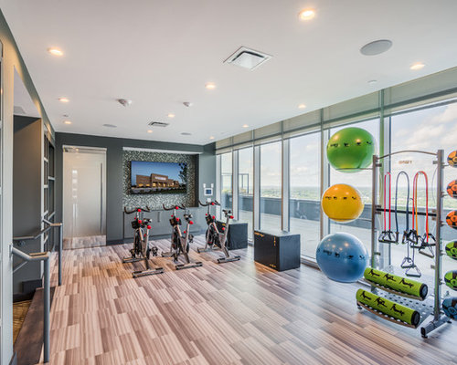 Inspiration For A Contemporary Brown Floor Multiuse Home Gym Remodel In Charlotte With Gray Walls