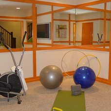 Eclectic Home Gym by Carlyn And Company Interiors + Design