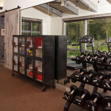 Rustic Home Gym by Carney Logan Burke Architects