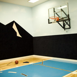 This is an example of a large classic home gym in Salt Lake City with multi-coloured walls and plywood flooring.