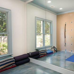 Design ideas for a small coastal home gym in Atlanta with concrete flooring and blue floors.