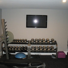 Traditional Home Gym by Johnston Built, LLC