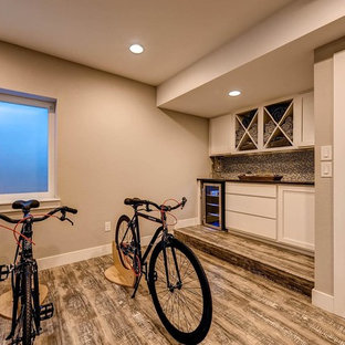 This is an example of a large arts and crafts multipurpose gym in Denver with beige walls and laminate floors.