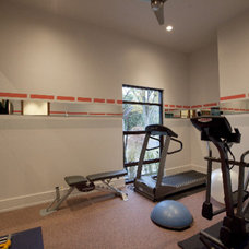 Modern Home Gym by Amelie de Gaulle Interiors