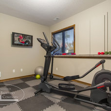 Traditional Home Gym by Finished Basement Company