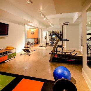 Photo of a contemporary multi-use home gym in Atlanta with concrete flooring and orange floors.