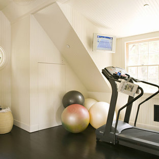 Design ideas for a transitional home gym in Los Angeles with white walls and black floor.
