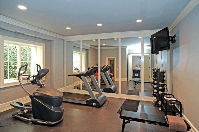 Traditional Home Gym by PCH, Inc.