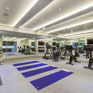 Photo of a large contemporary multi-use home gym in Miami with white walls and cork flooring.