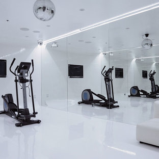 Example of a minimalist white floor home gym design in Los Angeles