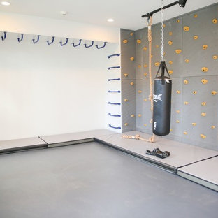 Inspiration for a medium sized modern home gym in New York with grey walls.