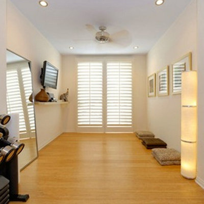 Home weight room - mid-sized light wood floor home weight room idea in Other with white walls