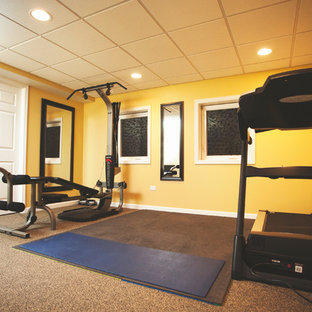Inspiration for a mid-sized modern carpeted multiuse home gym remodel in Chicago with yellow walls