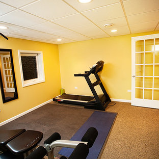 Mid-sized minimalist carpeted multiuse home gym photo in Chicago with yellow walls