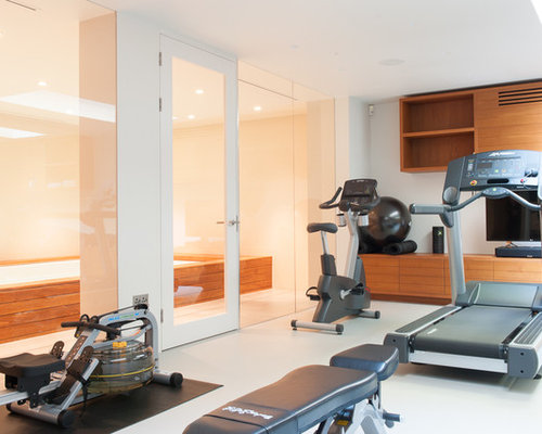 Photo Of A Contemporary And Modern Home Weight Room In London With White  Floors.