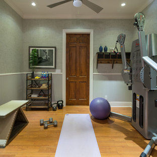 Design ideas for a small traditional home weight room in Miami with grey walls, medium hardwood flooring and yellow floors.