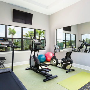 Design ideas for a medium sized traditional multi-use home gym in Orlando with grey walls, cork flooring and green floors.
