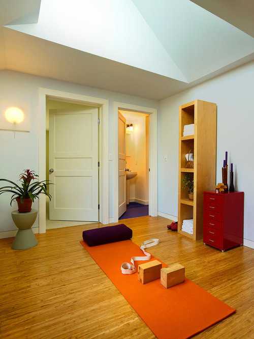 example of a classic home yoga studio design with bamboo floors