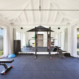 Transitional home gym in Central Coast with white walls.