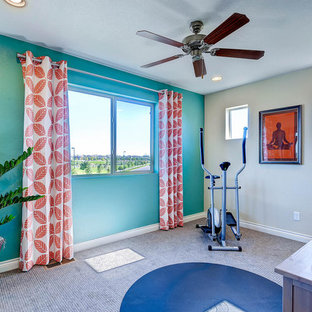 This is an example of a traditional multi-use home gym in Denver with blue walls and carpet.