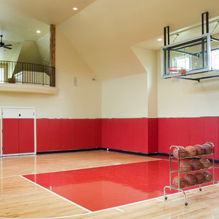 Example of a huge minimalist light wood floor home gym design in Kansas City with beige walls