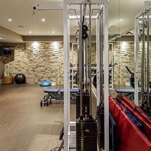 75 most popular home gym with brown walls and beige floors