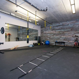 Inspiration for a large classic multi-use home gym in Calgary with grey walls, cork flooring and black floors.