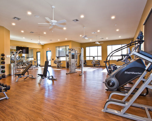 Best contemporary home gym with yellow walls design ideas