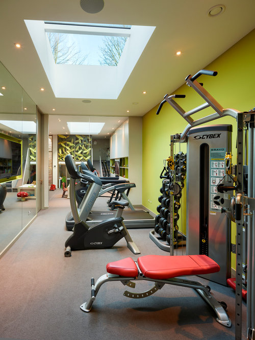 moderner fitnessraum mit gr nen w nden einrichten home gym heim fitnessstudio houzz. Black Bedroom Furniture Sets. Home Design Ideas