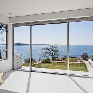 Minimalist gray floor home yoga studio photo in New York
