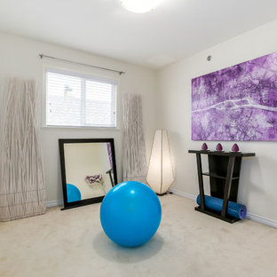 Photo of a medium sized traditional multi-use home gym in Los Angeles with grey walls, carpet and white floors.