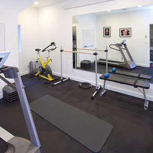 This is an example of a midcentury multipurpose gym in Seattle with white walls.