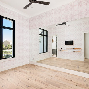 Inspiration for a traditional home gym in Phoenix with pink walls, light hardwood flooring and beige floors.