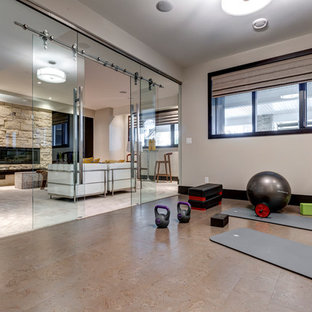 Design ideas for a large contemporary home yoga studio in Calgary with white walls.