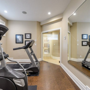 Photo of a small transitional multipurpose gym in Calgary with beige walls and cork floors.
