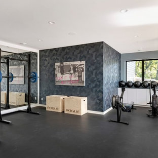 Example of a trendy black floor home gym design in Minneapolis with gray walls