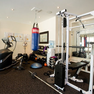 This is an example of a medium sized coastal home weight room in Newark with beige walls.