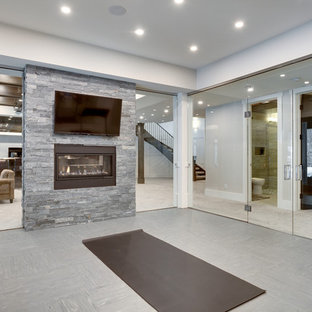Inspiration for a large transitional multipurpose gym in Calgary with grey walls and grey floor.