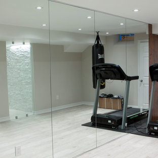 Inspiration for a large modern laminate floor and gray floor home weight room remodel in Toronto with gray walls