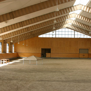 Inspiration for a huge timeless indoor sport court remodel in Portland with brown walls