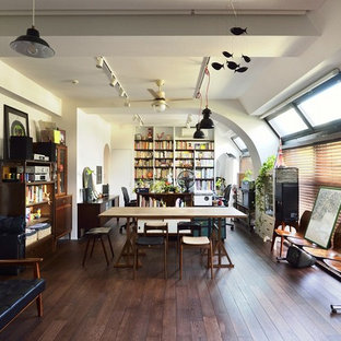 Freestanding desk dark wood floor and brown floor home office photo in Tokyo Suburbs with white walls