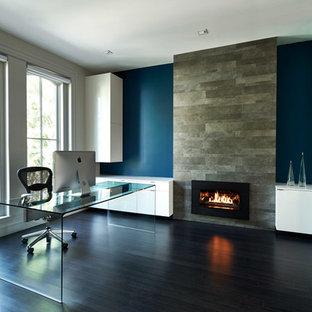Example of a trendy freestanding desk dark wood floor home office design in DC Metro with blue walls