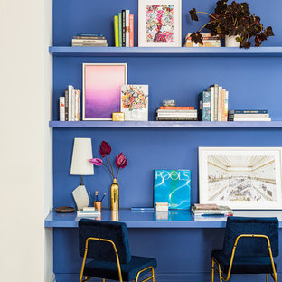 Inspiration for a contemporary built-in desk light wood floor and beige floor study room remodel in New York with blue walls