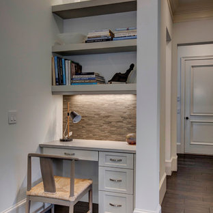Inspiration for a small transitional built-in desk dark wood floor home office remodel in Orlando with white walls