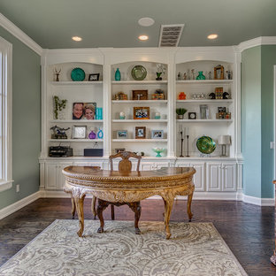 Inspiration for a large timeless freestanding desk dark wood floor study room remodel in Oklahoma City with green walls and no fireplace